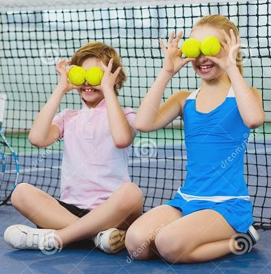 Children having fun playing tennis court 69829510